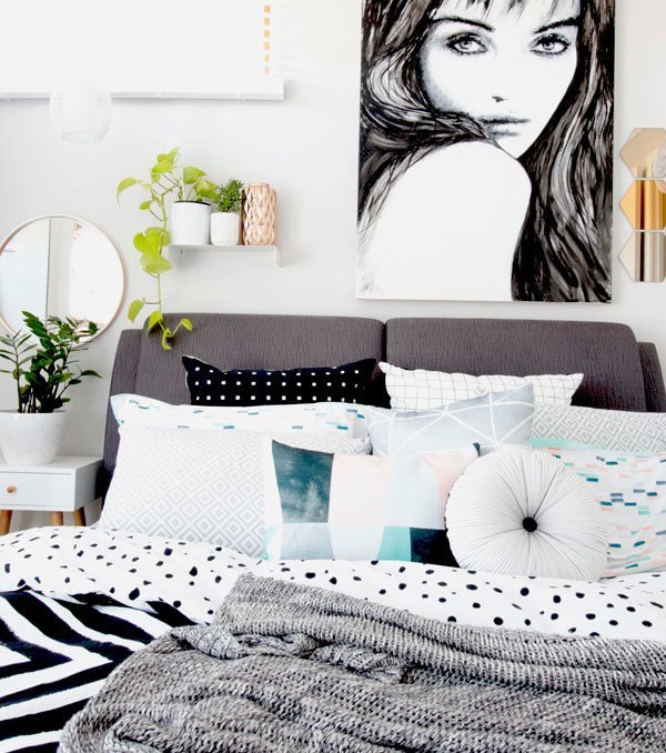 """Take All I Can Get"" black and white monochrome female portrait painting by Australian artist Kate Fisher. Styled in modern scandi master bedroom with adairs, Kmart and Ikea accessories."