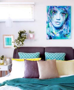 """Big Girls Don't Cry"" colourful female abstract portrait original artwork by Australian artist Kate Fisher hanging on the wall in modern master bedroom with adairs and kmart items."