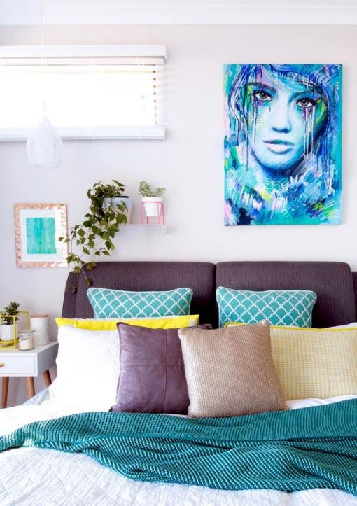 """""""Big Girls Don't Cry"""" colourful female abstract portrait original artwork by Australian artist Kate Fisher hanging on the wall in modern master bedroom with adairs and kmart items."""