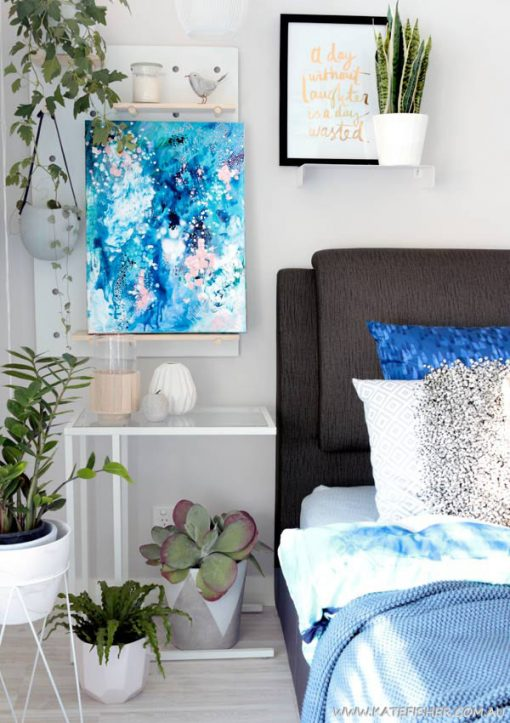 """When Snow Falls"" original abstract artwork in blues by Australian artist Kate Fisher. Styled in master bedroom with adairs bedding, kmart pegboard and indoor plants."