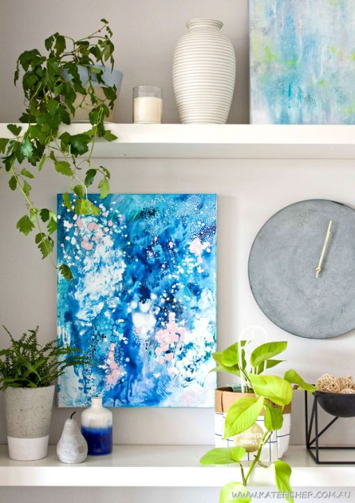 """When Snow Falls"" original abstract artwork in blues by Australian artist Kate Fisher. Styled on living rooms shelves with kmart items."
