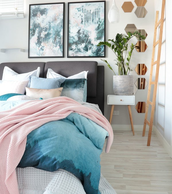 Nordic Sky Storm abstract art prints by Kate Fisher in moody blues, greys and pink. In modern scandi bedroom with adairs bedding.