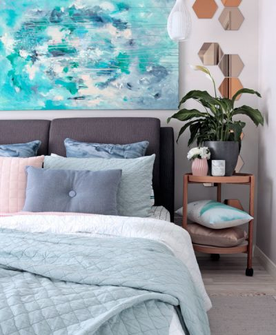 Contemporary bedroom styling in grey, sage and blue with adairs bedding and Kate Fisher original art painting